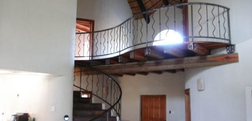 Interior spiral hardwood steel staircase