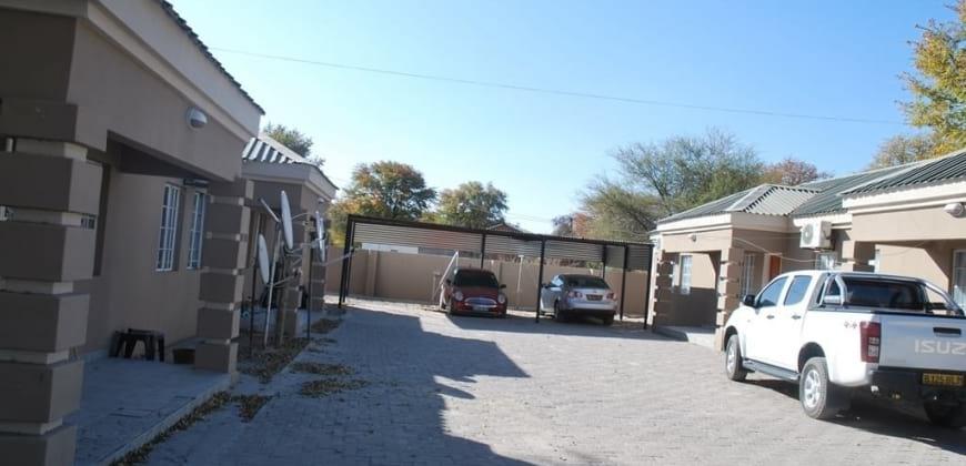 Paved driveway/carport